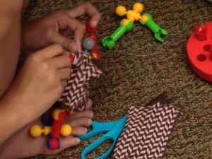 Students designing tiny fashionable dresses.